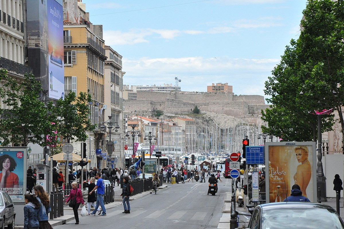 1200px-Marseille_(France),_Canebière_and_Fort_Saint-Nicolas